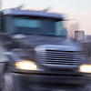 moving by large american mack truck on freeway