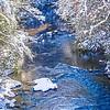 winter wonderland landscape along mountain river