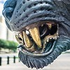 black panther statue closeup of teeth with city background