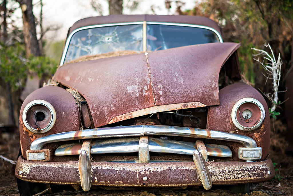 old timer abandoned automobile on the farm