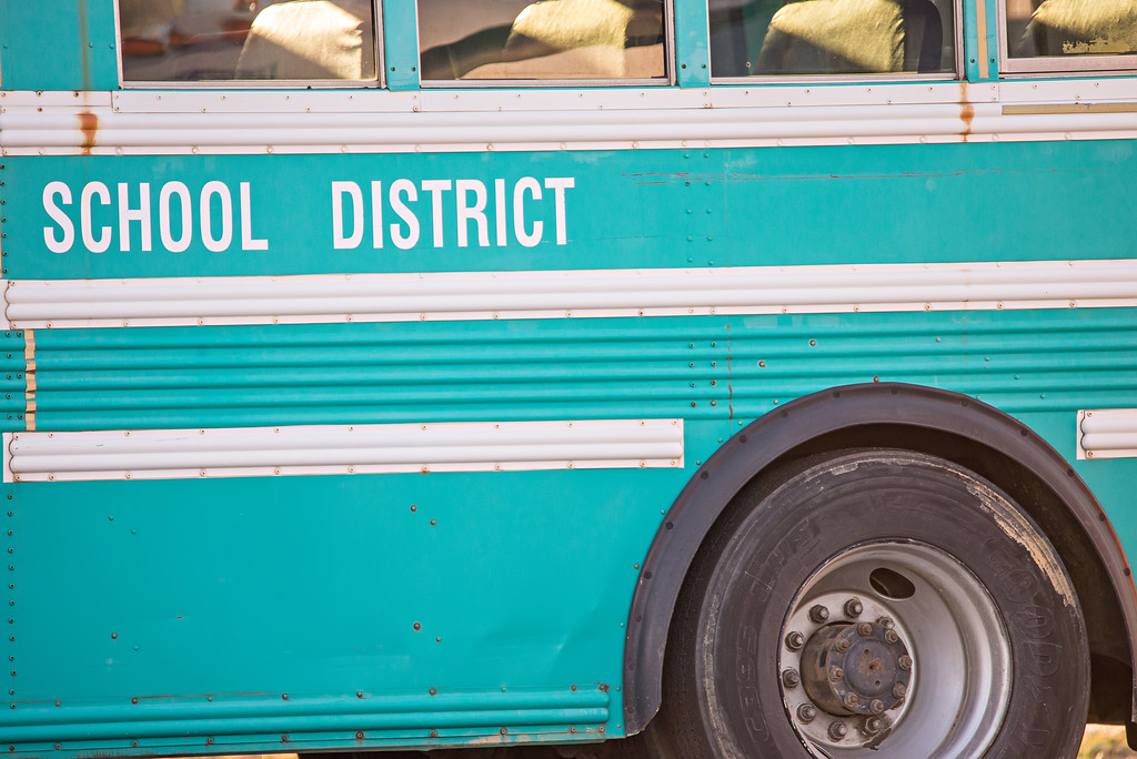 american school activity student ride bus