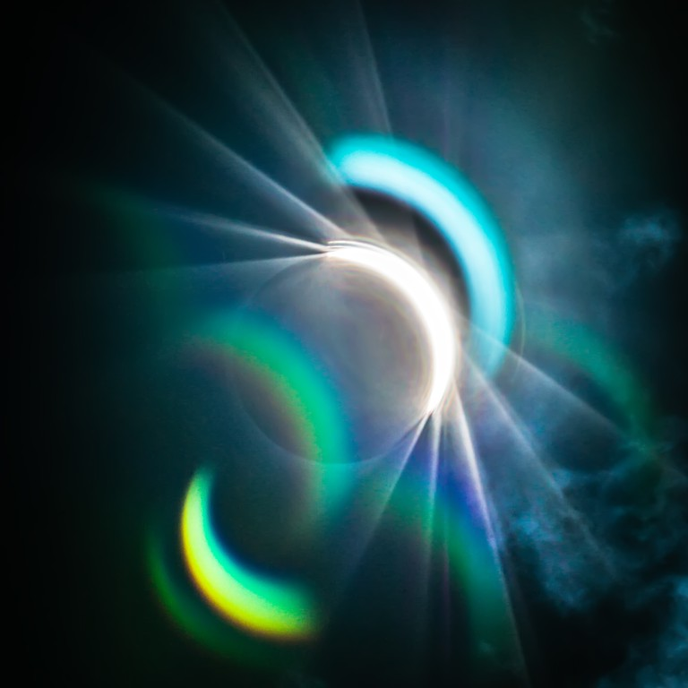 Partial Solar Eclipse Through Clouds