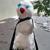 tiny blue eyed snowman with a scarf