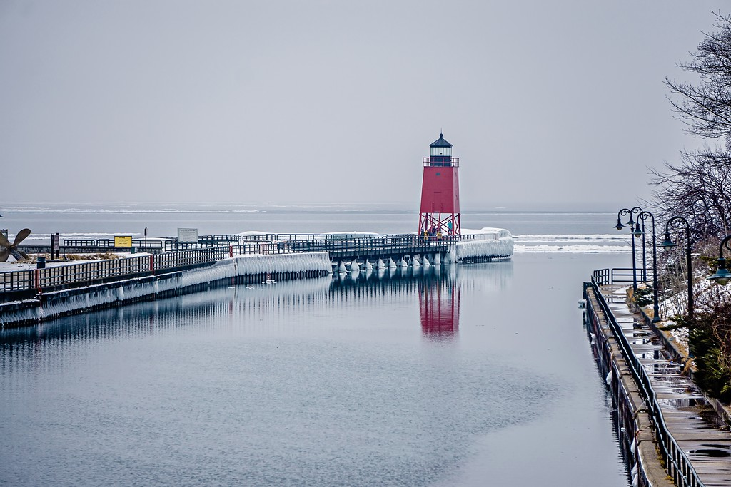 town of Charlevoix and South Pier Lighthouse on lake michigan