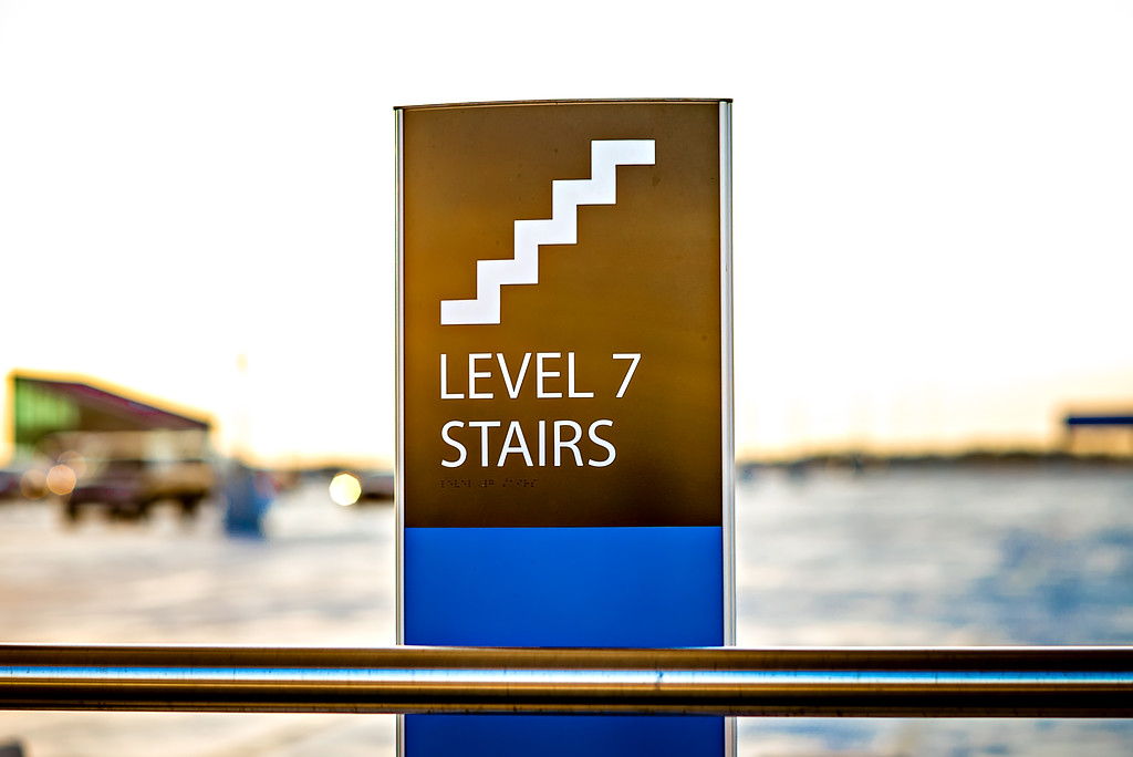 parking lot stairs and stair sign