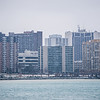 downtown windsor canada city skyline across river in spring winter storm