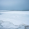 frozen over bear lake adjacent to lake michigan