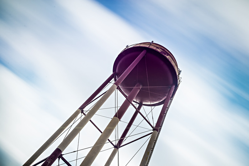 long exposure sky and clouds with water tower