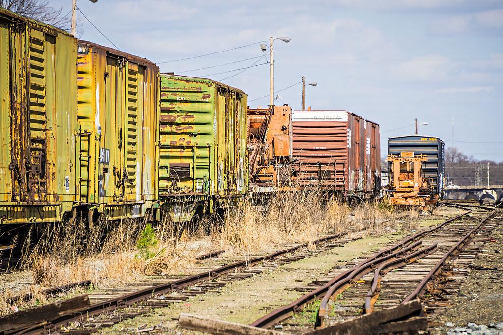 abandoned train tracks and wagons on railroad