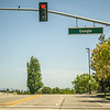 May 2017 Cupertino California Google - Google street name and empty road  with street light