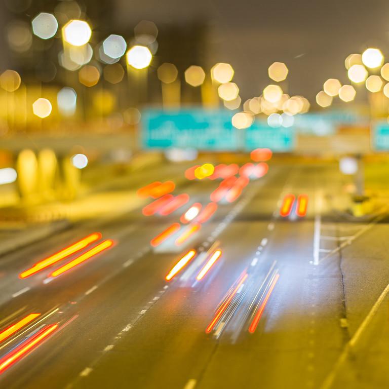 Cars on freeway at night