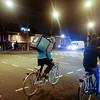Nederland, Amsterdam, Zeeburgerdijk, maaltijdbezorger van Deliveroo aop de fiets, , 4 januari 2017, foto: Katrien Mulder