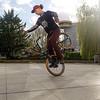 Nederland, Amsterdam, jongen traint met acrobatiek fiets, 17 april 2017, foto: Katrien Mulder