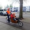 Nederland, Amsterdam, Koningsdag, happy family met vrouw en kind in bakfiets en man achter het stuur; 27 april 2017, foto: Katrien Mulder