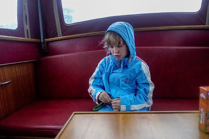 Nederland, Amsterdam, boottochtje in de regen, 30 augustus 2017, foto: Katrien Mulder