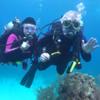Gilda and Warren underwater