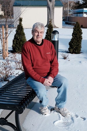 Joed Viera/Staff Photographer-Newfane,NY-Town Supervisor Timothy Horanburg sits at Veterans Memorial Park.