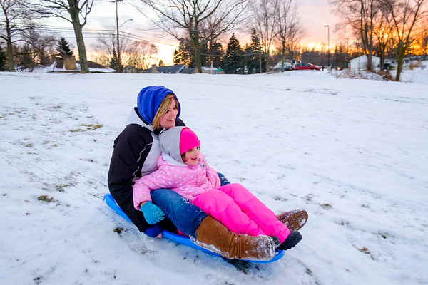 Joed Viera/Staff Photographer- Lockport, NY-Rebecca Brady and her daughter Britton, 6,  sled at Lockport Town and Country Club.