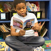 Joed Viera/Staff Photographer-Lockport, NY-Nathaniel Davis, 7, reads a Scholastic News Book about Martin Luther King Jr. at Charles Upson Elementary School. Davis says he learned about the minister from his mother who had watched a documentary about the 13th Amendment.