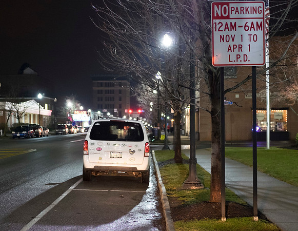 Joed Viera/Staff Photographer-Lockport, NY-A car parks on Main Street.