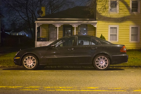 Joed Viera/Staff Photographer-Lockport, NY-A car parks on Walnut Street.