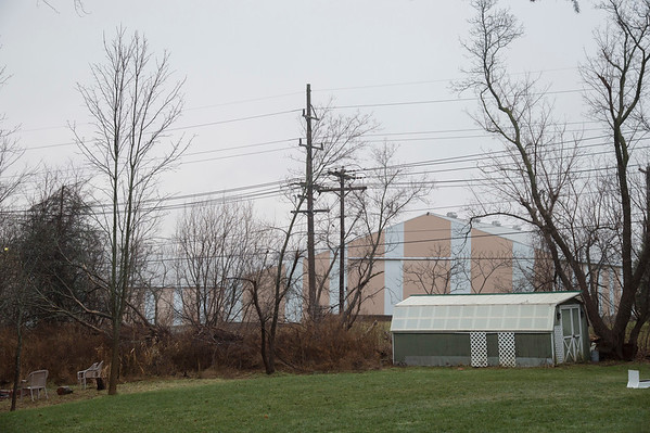 Joed Viera/Staff Photographer-Lockport ,NY-David Marotta claims the proposed cell tower will be located behind these salmon colered buildings.