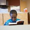 "Joed Viera/Staff Photographer-Tyson Triplette, 8, reads ""Five Nights at Freddy's"" inside the Williamsville YMCA's kitchen."