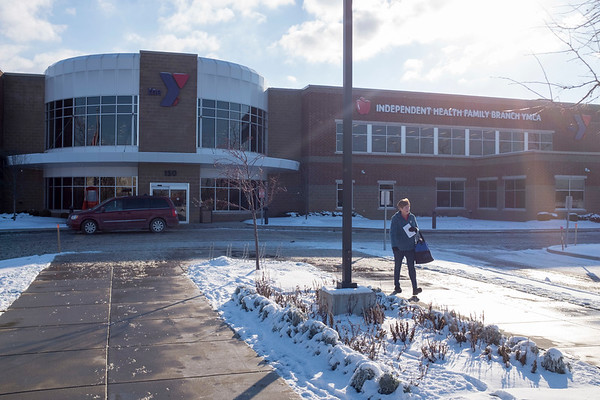 Joed Viera/Staff Photographer-A woman walks outside of the Williamsville YMCA.