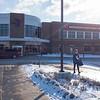 Joed Viera/Staff Photographer-A woman walks outside of the Williamsville YMCA.