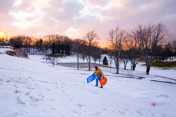 Joed Viera/Staff Photographer- Lockport, NY-Shamus Brady and his daughter Britton, 6, climb a hill after sledding at Lockport Town and Country Club.