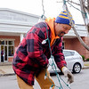 Joed Viera/Staff Photgrapher-City worker Scott Cercone removes holiday decorations from the trees on Main Street's medians on January, 4, 2016 in Lockport, N.Y. For residents wondering what to do with their Christmas trees: In the Town trees are considered one of residents six bags of refuse. In the City trees are considered separate from normal garbage and are picked up by the city chipper which goes out year round and loosely follows the garbage route. It is recommended to not wrap the trees and to place the trunks out towards the curb.