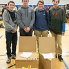 Joed Viera/Staff Photographer-Sanborn, NY-(from left) Newfane High School Students Micheal Fuller, 17, Jon Porth, 17, Colin Dodge, 14 and Aaron Bacon, 14, stand behind a pair of cardboard chairs Newfane students made for the Tech Wars competition. The chair on the left, made by Gwen Goodehough and Page Dent placed third in the competition and the chari on the right, made by Dodge and Bacon place first.