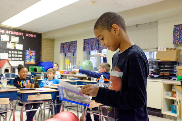 Joed Viera/Staff Photographer-Lockport, NY-Lavani Miles reads a book about Martin Luther King Jr. to his classmates in front of Mattina Beatrice's 3rd grade class at Charles Upson Elementary School in Lockport