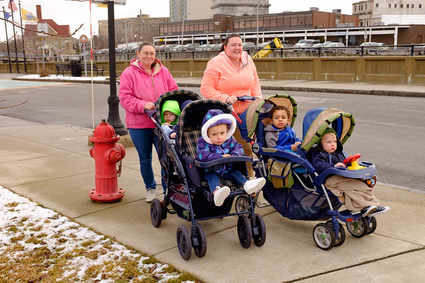 Joed Viera/Staff Photographer- Lockport, NY-Cindy Howard and Amanda Foster stroll pre-school students from Happy Times around the Historic District.