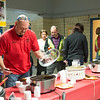 "Joed Viera/Staff Photographer-Jeff Grimes scoops up some ""LJ's Chili""  at the fourth annual chili cook-off at the GM Components Lockport plant. The chili recipe, prepared by him and his Wife Lauri won last years title."