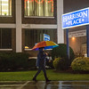 Joed Viera/Staff Photgrapher-Lockport, NY-Amy Smith walks through some January rain down Washburn Street.