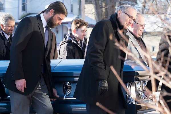 Joed Viera/Staff Photographer-Pallbearers carry the casket of former Lockport Mayor Thomas C. Rotondo Jr. into St. Johns.