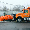 Joed Viera/Staff Photographer-Lockport ,NY-A Niagara County plow waits for a train to cross an icy Niagara Street.