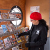 "Joed Viera/Staff Photographer-Olcott ,NY-Newfane 365 organizer Gina Guido-Redden spruces up the visitors center located inside their ""Caboose""."