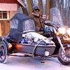 "Joed Viera/Staff Photographer-Mike Evans rides his Honda Shadow through the snow. Evans has been riding his motorcycle in the winter for over a decade. According to Evans the most difficult thing about driving in the snow is ""the other idiots driving in the snow...slow down, its a simple thing."""