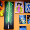 Joed Viera/Staff Photgrapher-Earth House's featured artist Garrett Dykstra's paintings hang on the walls of  the shop on Wendesday.