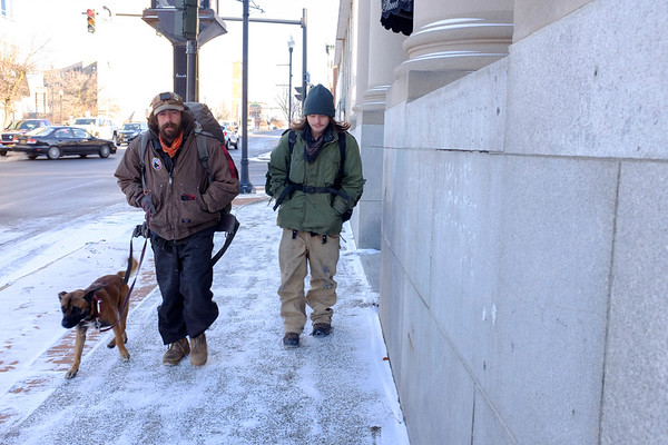 Joed Viera/Staff Photographer-Buskers Chuck Fin and Robert Baggins walk their dog Appolla down Main Street. The travelers  are attempting to make their ways down south for the winter.