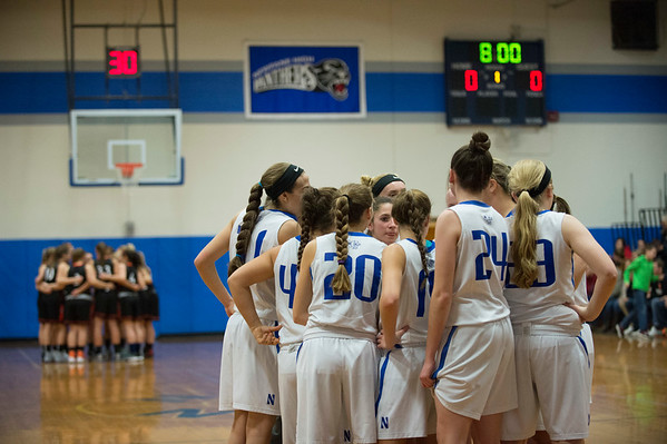 Joed Viera/Staff Photographer-Newfane, NY-Wilson and Newfane players huddle before their High School basketball game.