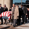 Joed Viera/Staff Photographer-Pallbearers carry the casket of former Lockport Mayor Thomas C. Rotondo Jr. out of St. Johns.