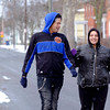 Joed Viera/Staff Photographer- Lockport, NY-Snow falls as Terry Tennyson and Luisa Moralez take a stroll down Genesse Street to a friends house.