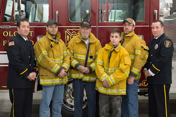 Joed Viera/Staff Photographer-Olcott ,NY-The Miller family gathers in front of Engine No. 2 at the Olcott Volunteer Fire Company.<br /> Pictured from left to right,  Michael Miller,  Jeff Grimes Jr, Clifford Miller Sr, jr. firefighter Jacob Miller, Jonathan Miller, and Steve Miller.