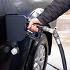 Joed Viera/Staff Photographer-A customer fuels his truck from pump No. 1 at Scapelliti's Super Store. Monday morning a credit card skimming device was removed from pump No. 1. Tuesday afternoon three suspects were arrested making purchases with fradulent credit cards  the Walmart in Albion