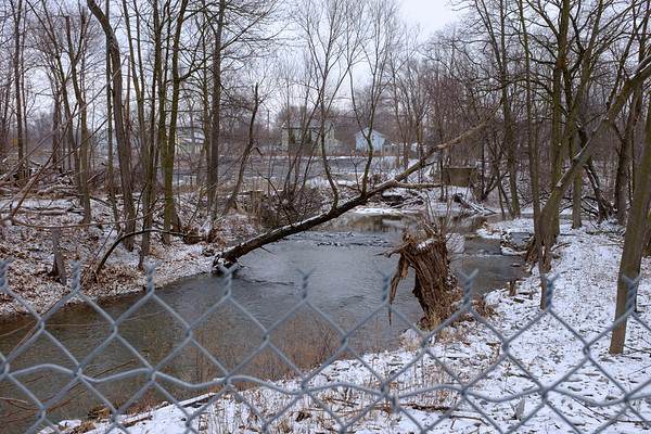 Joed Viera/Staff Photographer- Lockport, NY-Eighteen Mile Creek flows behind the former Flintkote Plant at 198 Mill Street. The EPA's clean-up phase involves removing PCBs, lead and other contaminents from the creek.