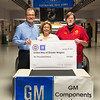 Joed Viera/Staff Photographer-GM plant manager Bill Tiger, left,  and UAW 686 Chairman Mike Branch, right,  present interim president of the United Way of Greater Niagara Connie Brown a check during the fourth annual chili cook-off at the GM Components Lockport plant.