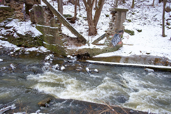 Joed Viera/Staff Photographer- Lockport, NY-Eighteen Mile Creek flows behind the former White Transportation property at 30 Mill Street. The EPA's clean-up phase involves removing PCBs, lead and other contaminents from the creek.